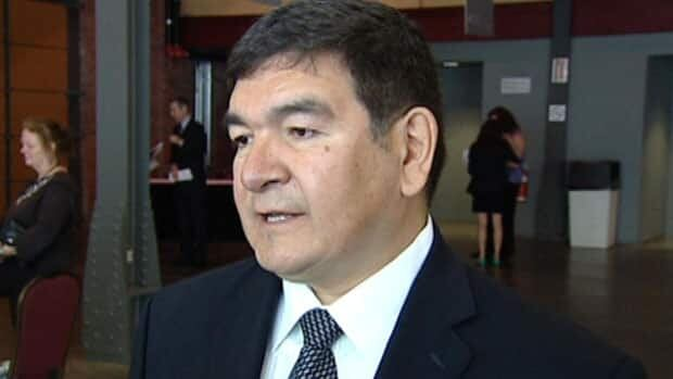 The NDP says Tory cabinet minister Peter Penashue, seen speaking in Halifax last week, should take responsibility for spending mistakes in the 2011 campaign.