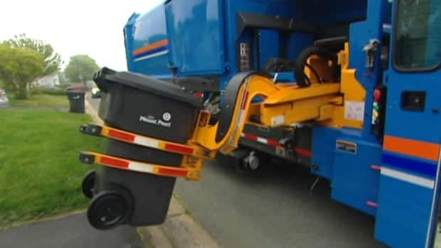 Automated garbage trucks use robotic arms to pick up special bins and dump trash in the truck.