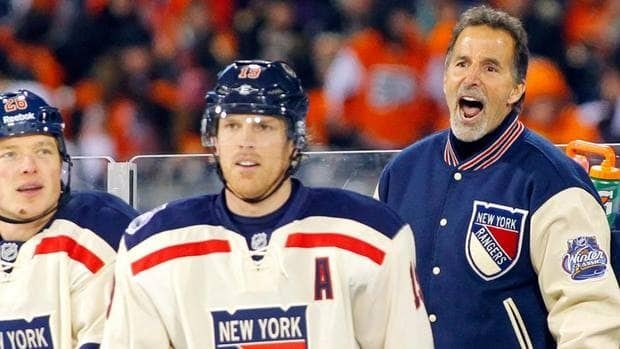 New York Rangers coach John Tortorella, right, argues a penalty call as Ruslan Fedotenko, left, and Brad Richards look on late in the third period of the NHL Winter Classic on Monday.