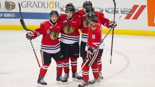 Members of the Portland Winterhawks celebrate a goal against the Saskatoon Blades Wednesday night.