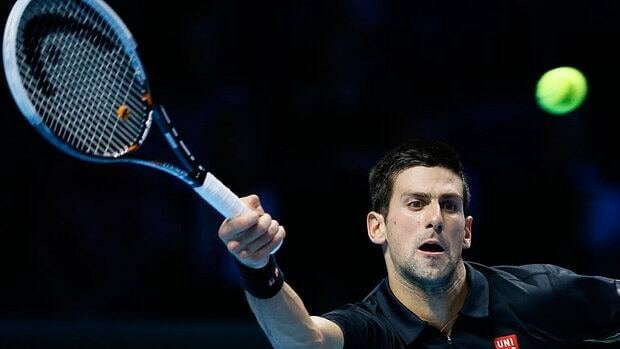 Novak Djokovic plays a return to Tomas Berdych en route to a 6-2, 7-6 (6) victory in their singles match at the ATP finals.