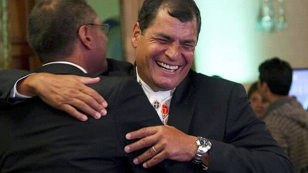 Ecuador's leftist President Rafael Correa, facing camera, was re-elected on Sunday, winning another four year mandate.