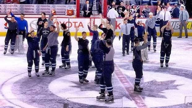 Members of the Winnipeg Jets wave to their fans at the end of their season-closing game Thursday, after the Montreal Canadiens won 4-2 and the Jets were eliminated from playoff contention.