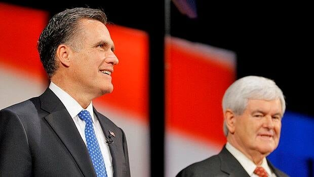 Republican presidential candidates Mitt Romney and Newt Gingrich stand on stage Monday night at the candidates debate in Tampa, Fla. Romney's high income and low tax rates were the focus of attention early Tuesday.