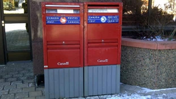 Two mailboxes outside the Civic Centre in Sydney. One is used for local mail, the other for mail headed outside of Cape Breton.
