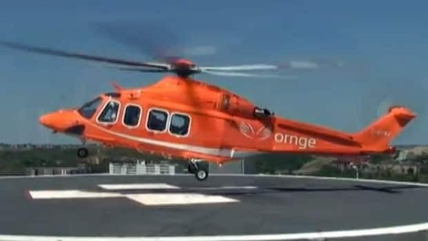 Ornge helicopter making a landing at the Sudbury hospital helipad.