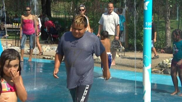 Winnipeg children beat the heat as temperatures soared in Manitoba Sunday, breaking several records.