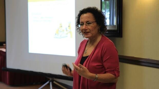 Shelle Rose Charvet, CEO of Weongozi, speaks at a conference in Burlington Thursday. She is a finalist in this year's Lion's Lair competition.
