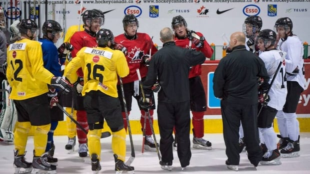 Team Canada junior prospects listen to coaching staff during training camp in Brossard, Que., on Sunday.