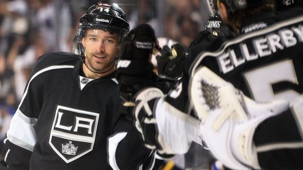 Justin Williams celebrates his game-winning goal for the Los Angeles Kings in Game 4 against the St. Louis Blues on Monday. Williams has two goals in four games.