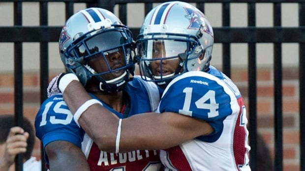 Montreal Alouettes slotback S.J. Green, left, is congratulated for his touchdown against the Edmonton Eskimos by teammate Brandon London last week in Montreal. After the game, London criticized officials and has been fined for his comments.