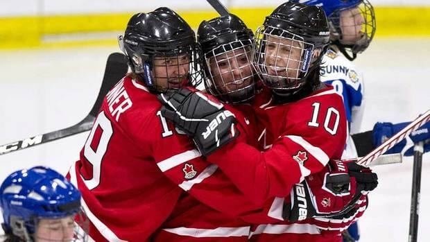 Team Canada Meghan Agosta, centre, is congratulated for her goal against Team Finland by teammates Brianne Jenner, left, and Gillian Apps during second period semi-final hockey action at the World Women's Ice Hockey Championships Friday. Canada won 5-1.