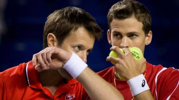 Daniel Nestor, left, and Vasek Pospisil helped Canada advance to the Davis Cup semifinals with a doubles win against Italy in April.