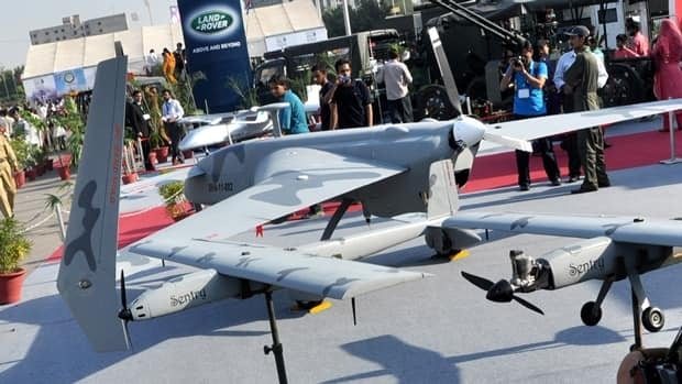 Visitors look at Pakistan-made unmanned aircraft at defense exhibition Thursday in Karachi, Pakistan.