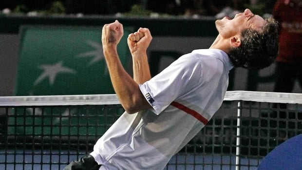 Jerzy Janowicz celebrates after winning his semifinal match against Gilles Simon at the Paris Tennis Masters