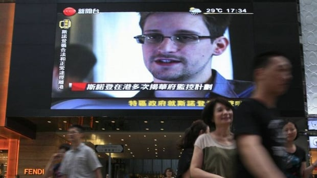 A TV screen shows a news report of Edward Snowden, a former CIA employee who leaked top-secret documents about sweeping U.S. surveillance programs, at a shopping mall in Hong Kong. Snowden hid in Hong Kong for several weeks before flying to Moscow on Sunday.