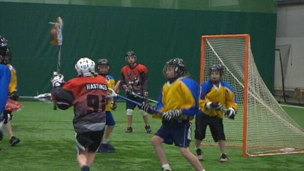 Players got a chance to try out lacrosse on the turf field in Stratford Monday.