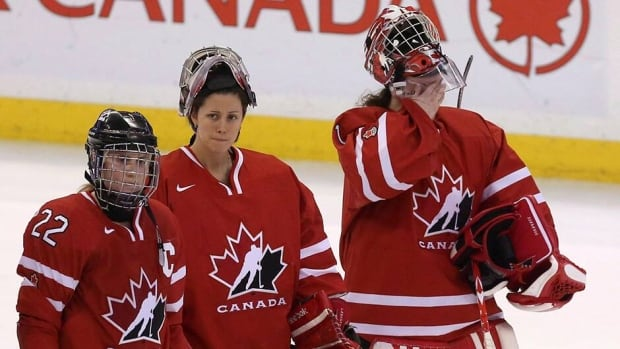 Charline Labonte, centre, and Shannon Szabados, right, seen here following Canada's loss to Team USA in the gold medal game at IIHF Women's World Ice Hockey championships in Ottawa in April, will be battling Genevieve Lacasse for the top job at the 2014 Winter Olympics.