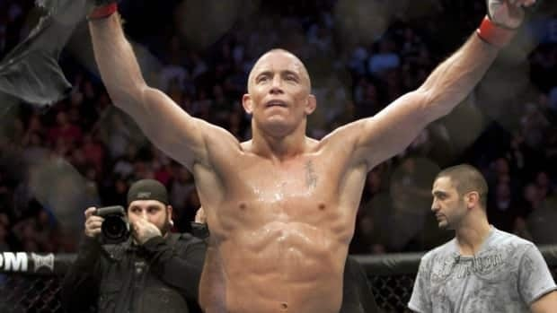 Georges St-Pierre, from Montreal, celebrates after defeating Josh Koscheck, from Waynesburg, PA., with a unanimous decision to retain his welterweight title at UFC 124 Sunday, December 12, 2010. MPs have passed a Senate bill that will make mixed martial arts and other combative sports legal.