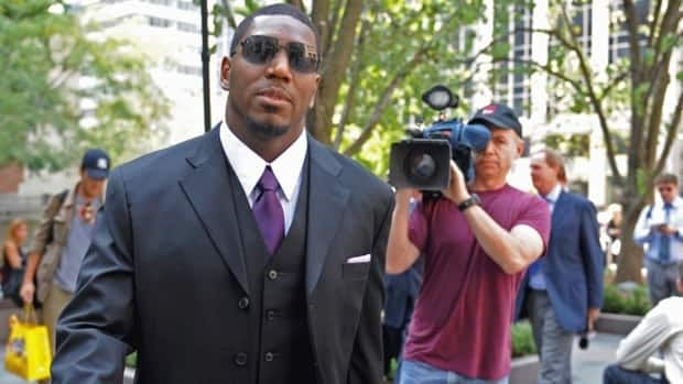 In this Sept. 17, 2012 file photo, New Orleans Saints linebacker Jonathan Vilma arrives at NFL headquarters to meet with commissioner Roger Goodell in New York.