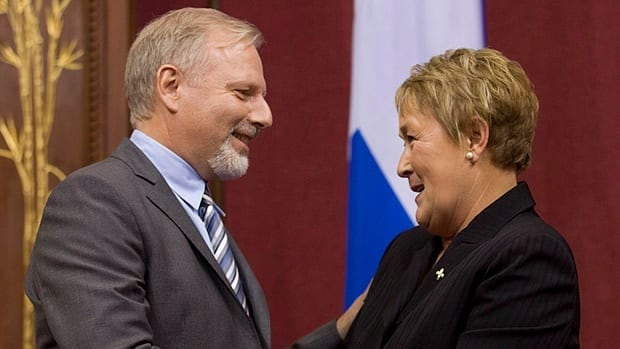 Quebec's new international relations minister Jean-François Lisée shakes hands with Premier Pauline Marois after being sworn into her cabinet last month. Lisée is raising concerns about the provisions of the free trade deal Canada's currently negotiating with Europe, suggesting Quebec's support is not guaranteed.