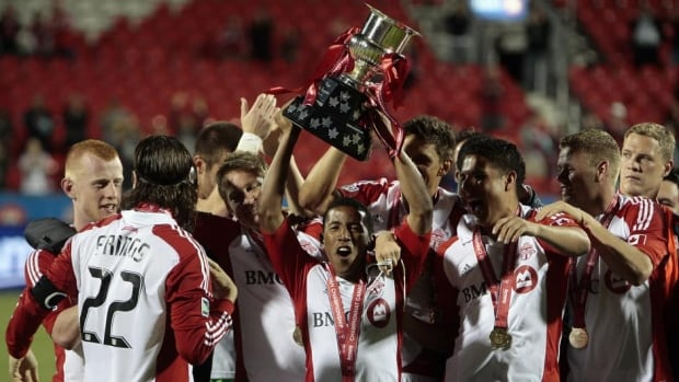 Toronto FC hoists the winners trophy after defeating the Vancouver Whitecaps FC 1-0 during the Canadian Championship final on Wednesday night.