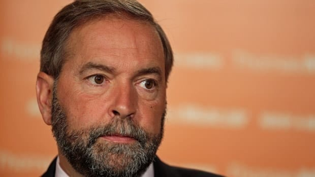 NDP Leader Tom Mulcair talks to the press at the party's annual summer caucus retreat in St. John's on Wednesday.
