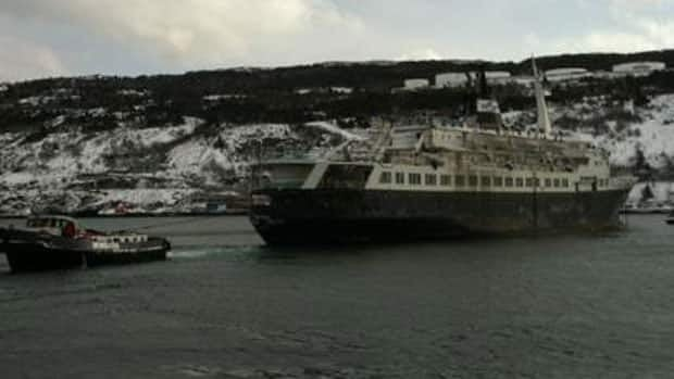 The Lyubov Orlova is towed out of St. John's Harbour on Wednesday.