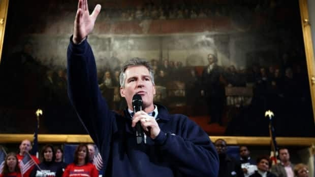 Massachusetts Senator Scott Brown rallies the troops at Boston's historic Faneuil Hall on Sunday. A Tea Party-backed Republican who won the late Edward Kennedy's seat in a surprise 2010 byelection, Brown is facing a tough fight.