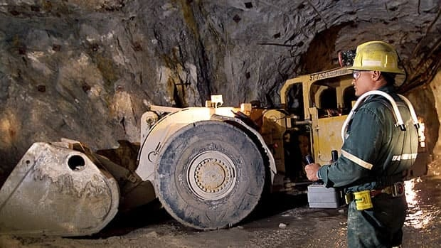 An operator runs heavy equipment by remote control in Cameco's Rabbit Lake mine in Saskatchewan.
