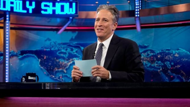 Jon Stewart, seen here in October 2012, returned Tuesday as host of The Daily Show after taking the summer off to direct and produce a movie.