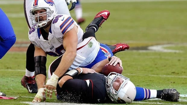 Arizona Cardinals quarterback Kevin Kolb, bottom, is injured after being hit by Buffalo Bills defensive end Chris Kelsay (90) during the second half Sunday.