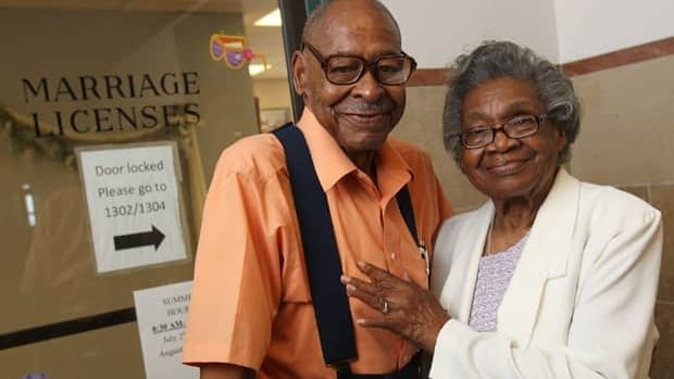 Roland Davis of Colorado and Lena Henderson of West Seneca, N.Y., pose for a photo at the Buffalo City Hall on Monday. At 85, they are remarrying.