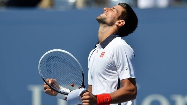 Novak Djokovic celebrates after winning his semifinal matchup against David Ferrer at the U.S. Open on Sunday.