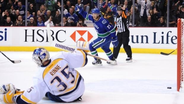 Canucks forward Manny Malhotra (27) scores on netminder Pekka Rinne in a 6-5 home loss to the Predators on Dec. 1, 2011.