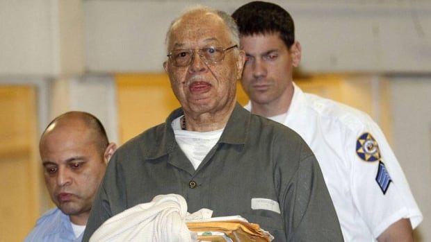 Dr. Kermit Gosnell is escorted to a waiting police van upon leaving the Criminal Justice Center in Philadelphia after being convicted of first-degree murder in the deaths of three babies who were delivered alive and then killed with scissors at his clinic.