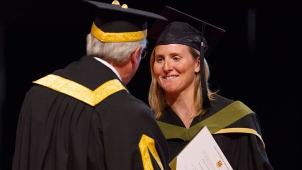 Canadian women's hockey team captain Hayley Wickenheiser shakes hands with Jim Dinning, Chancellor of the University of Calgary during a convocation ceremony in Calgary on Monday.