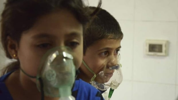 Children, affected by what activists say was a gas attack, breathe through oxygen masks in the Damascus suburb of Saqba, August 21. Syria's opposition accused government forces of gassing hundreds of people on Wednesday by firing rockets that released deadly fumes over rebel-held Damascus suburbs, killing men, women and children as they slept.