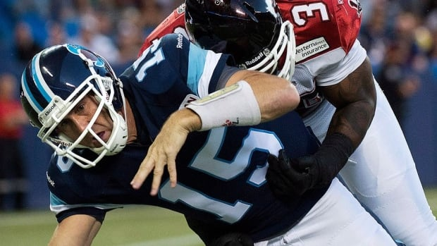 Argonauts quarterback Ricky Ray, left, injured his shoulder when tackled by Stampeders defensive lineman Charleston Hughes, right, in Friday's 35-14 loss to Calgary. Ray will be out of game action for about six weeks.