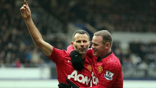 Manchester United's Ryan Giggs celebrates his goal with Wayne Rooney on Saturday.