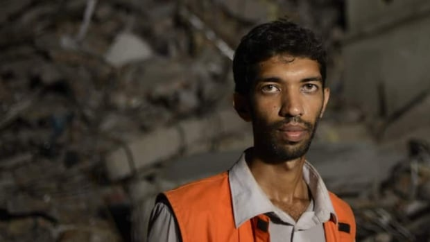 Saiful Islam Nasar, a mechanical engineer, is one of hordes of volunteers who rushed to the building collapse in Savar, near Dhaka, Bangladesh last week help with the rescue effort.