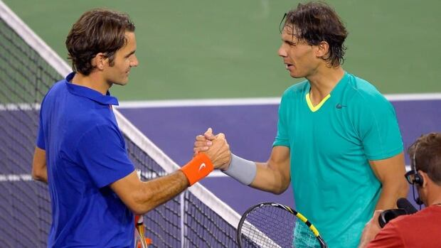 Rafael Nadal, right, shakes hands with Roger Federer after defeating him in their match at the BNP Paribas Open on Thursday in Indian Wells, Calif.