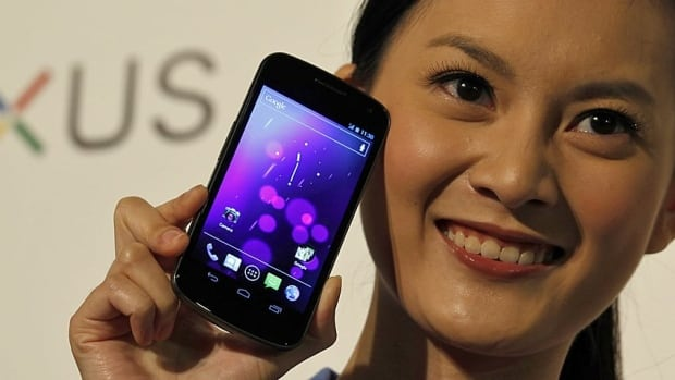 A model poses with the Galaxy Nexus phone. Samsung became the world's largest cellphone seller last quarter, with 20,000 devices sold every hour.