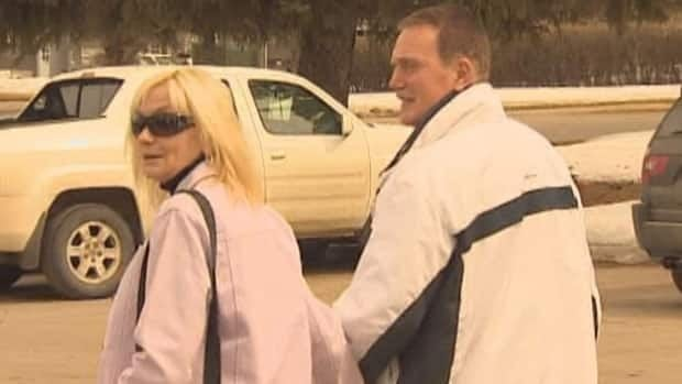 Bonnie McLachlan leaves court with her husband earlier in her trial. On Friday, after being found guilty of sexual exploitation of a student, McLachlan left court using a side door.