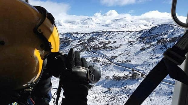 Rescue crew officer Luke Ashford uses a thermal imaging camera in a helicopter in this undated handout photo taken when Australian authorities conducting the search for Hamilton man Prabhdeep Srawn.