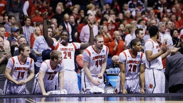 Louisville players react on the bench react in the final minutes of the second half of the Midwest Regional final against Duke on Sunday in Indianapolis. Louisville won 85-63 to advance to the Final Four.