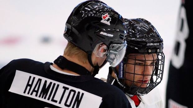 Jonathan Drouin, right, from Huberdeau, Que., speaks with Dougie Hamilton, from Toronto, Ont., during the National Junior hockey team selection camp in Calgary, Alta. on Tuesday.