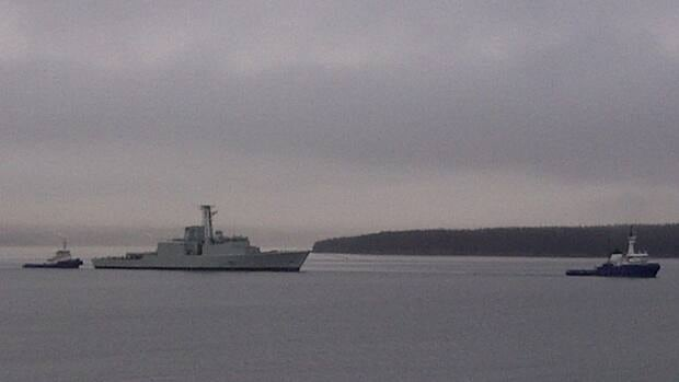HMCS Athabaskan is towed after undergoing a refit in Ontario.