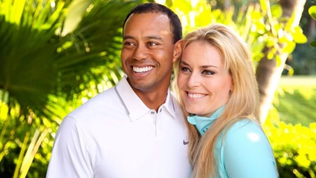 In this photo provided by Tiger Woods and Lindsey Vonn, the couple poses for a portrait.