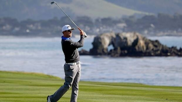 Hunter Mahan hits from the fairway on the 18th hole of the first round of the Pebble Beach Pro-Am on Thursday in Pebble Beach, Calif.